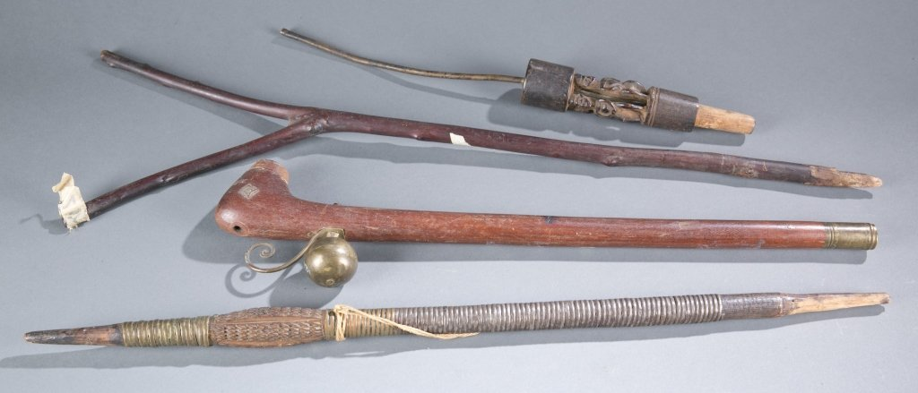 A group of four African implements.