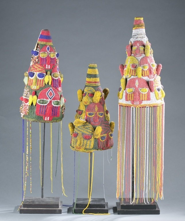 A group of three beaded crowns.