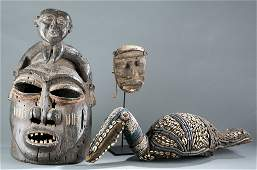 A group of three masks / headdress.