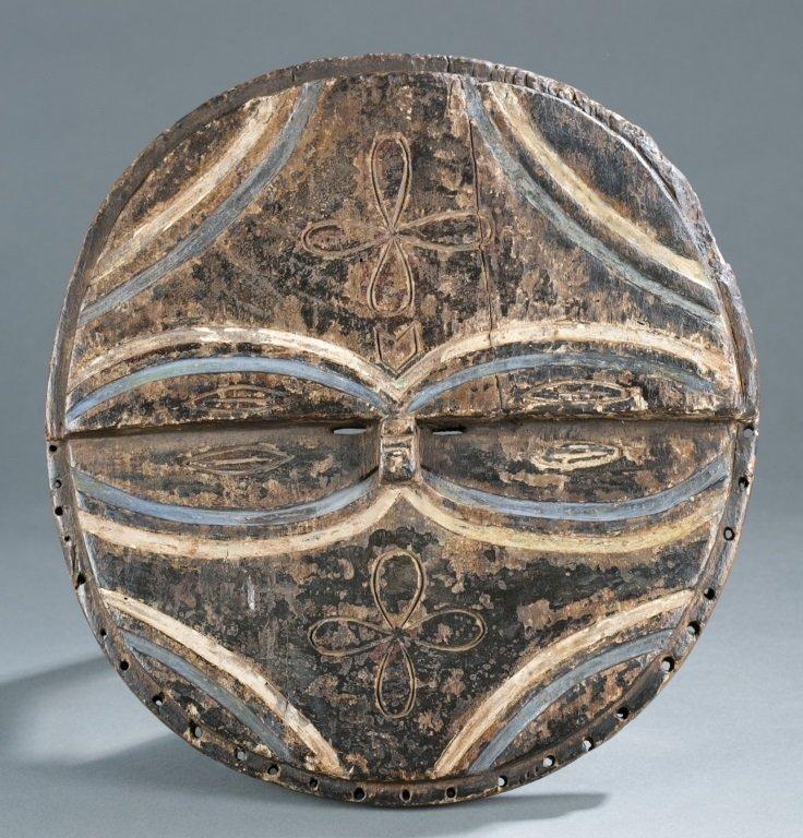 Teke wood mask with oval shaped eyes.