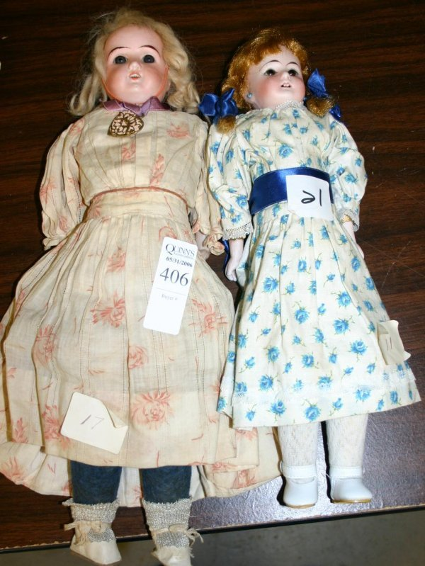 1406: Pair of straight necked bisque dolls with com