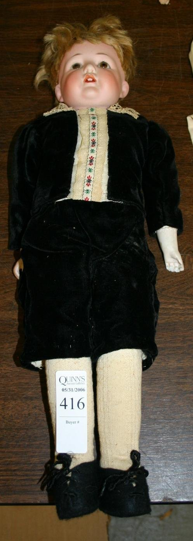 1416: Bisque porcelain boy doll, marked F.Y. on bac