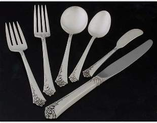 Heirloom sterling flatware set
