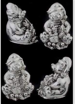Four silver bear figures