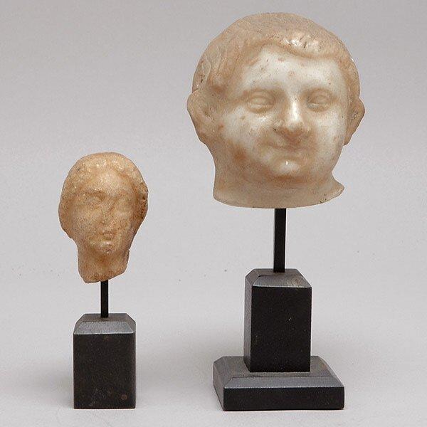 302: Two Greco-Roman Stone Heads
