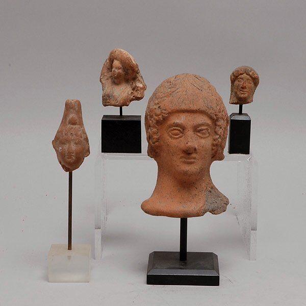 Four Mediteranean Red Clay Heads