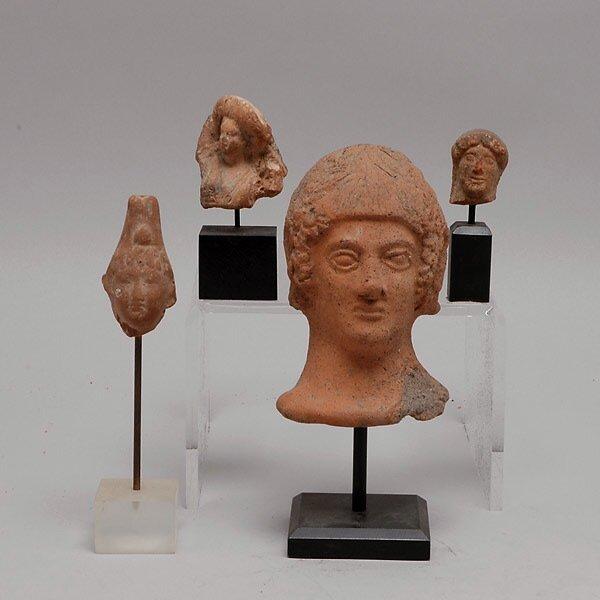 306: Four Mediteranean Red Clay Heads
