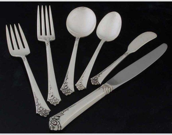 10: Heirloom sterling flatware set