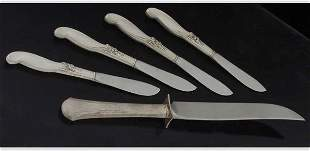 Four sterling cheese knives and a sterlin