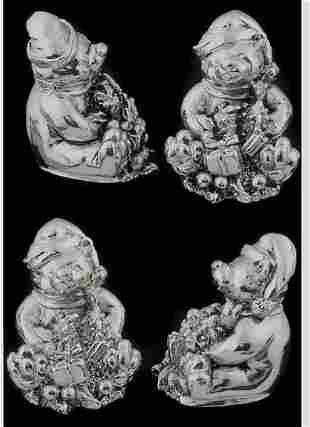 Four silvered metal Minature bears