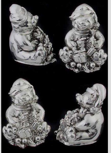 24: Four silvered metal Minature bears