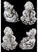 36: Four silvered metal Minature bears