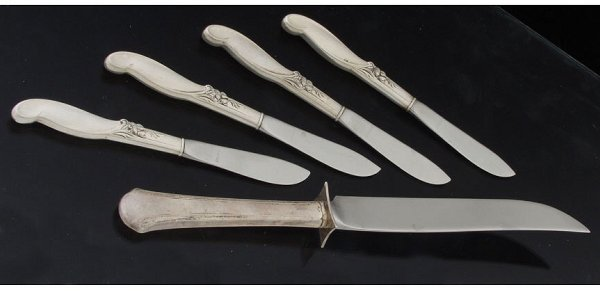 15: Four sterling cheese knives and a sterlin