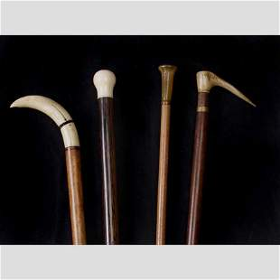 Two Carved wood walking canes with Ivory