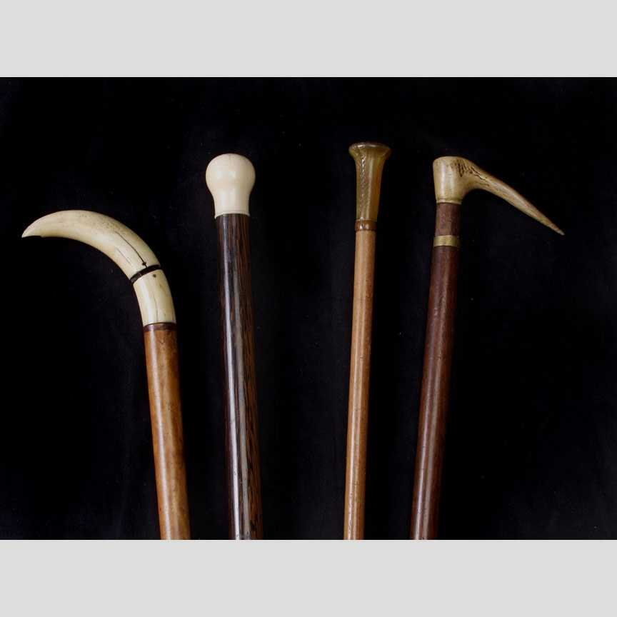 10: Two Carved wood walking canes with Ivory