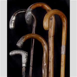 Five miscellaneous walking canes