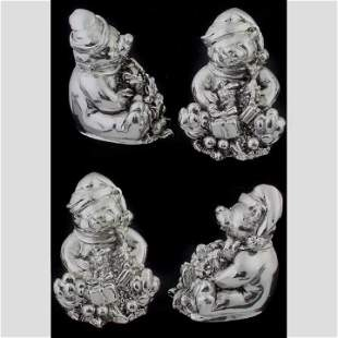 Four sterling bear figures