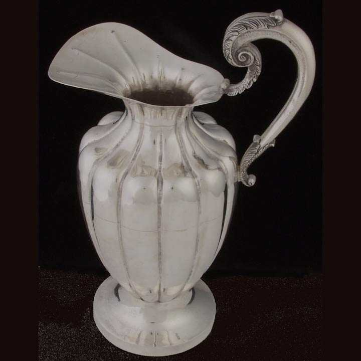17: Sterling silver water pitcher
