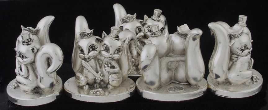 19: Five sterling squirrell figures
