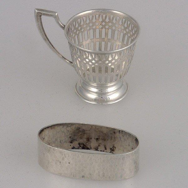 2: Sterling Napkin Ring & Demi tasse cup holder.