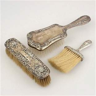 Three Floral Repousse Sterling Mounted Brushes