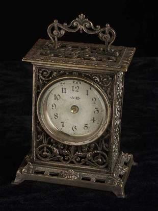 Openwork cast & silvered metal desk clock