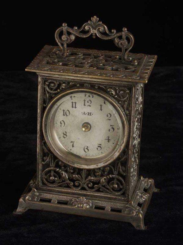 3: Openwork cast & silvered metal desk clock