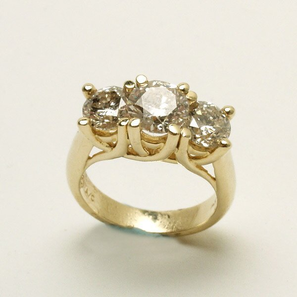 306: Diamond, 14K Yellow Gold Three Stone Ring