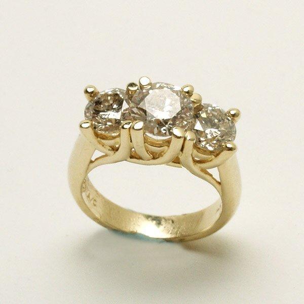 306: Diamond, 14K Yellow Gold Three Stone Ring