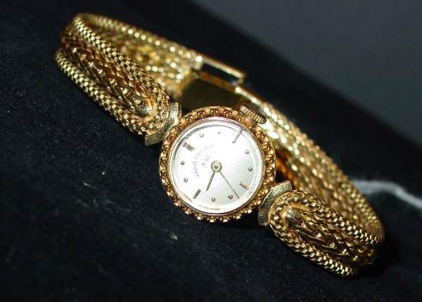 8: 18K Yellow Gold Swiss Lady's Wrist Watch