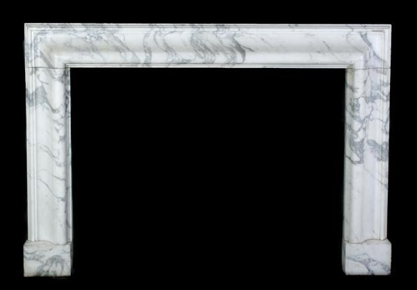 A white and grey Carrara marble chimneypiece, seco
