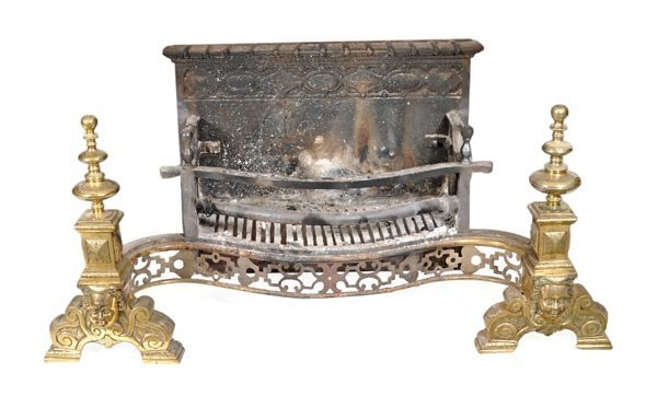 A cast iron and brass mounted firegrate in the Geo