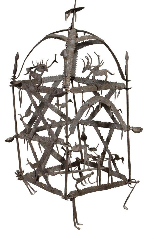 A wrought iron hanging frame in the form of a lant