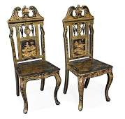 A pair of Victorian black lacquered and parcel gil