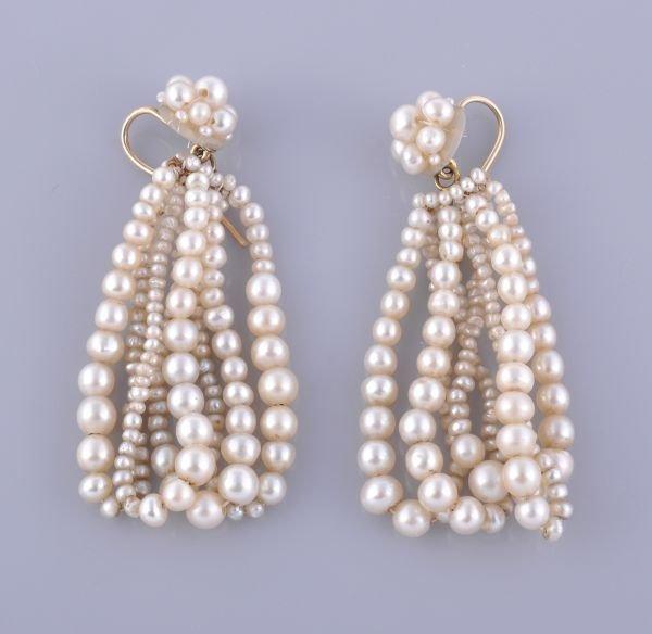 A pair of pearl hoop earrings , the earrings compo
