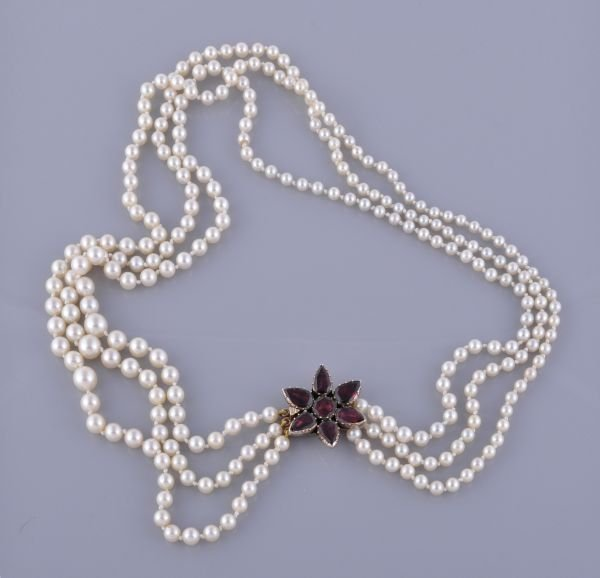 A three strand cultured pearl necklace,  composed