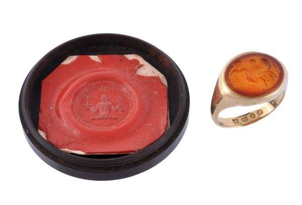A gentleman's signet ring,  the oval cornelian tab