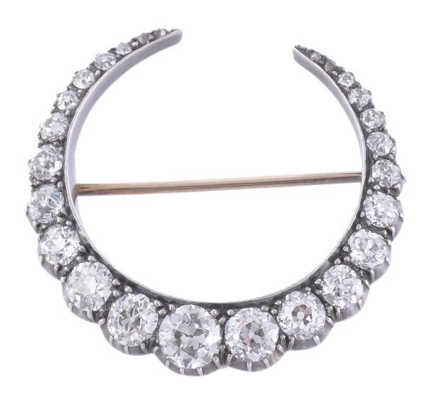 A late Victorian diamond crescent brooch,  circa 1