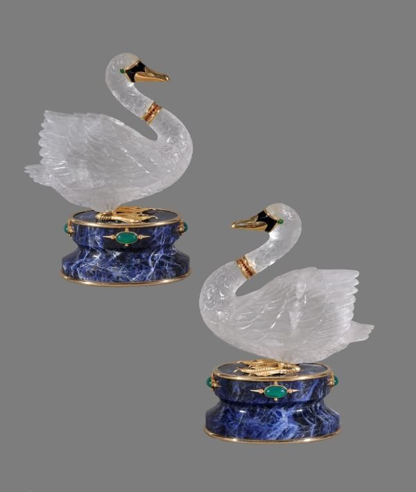 A pair of carved rock crystal and gem set swans by