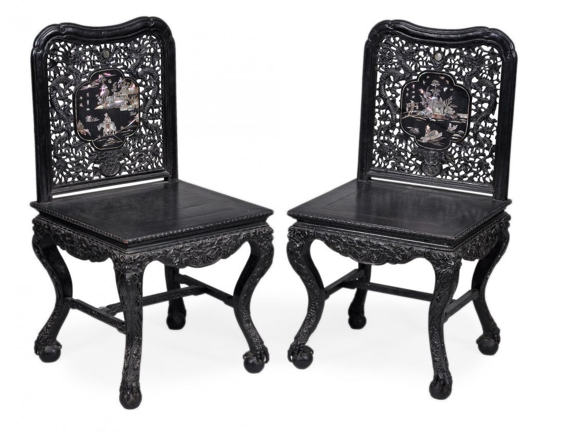 A pair of Chinese black wood armchairs 19th-20th c