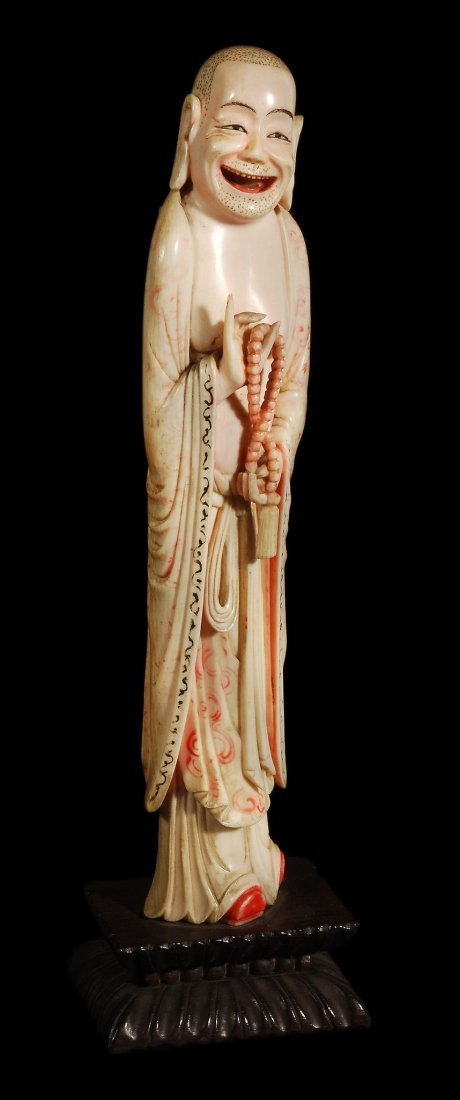 An ivory figure of Budai, 19th century, standing w