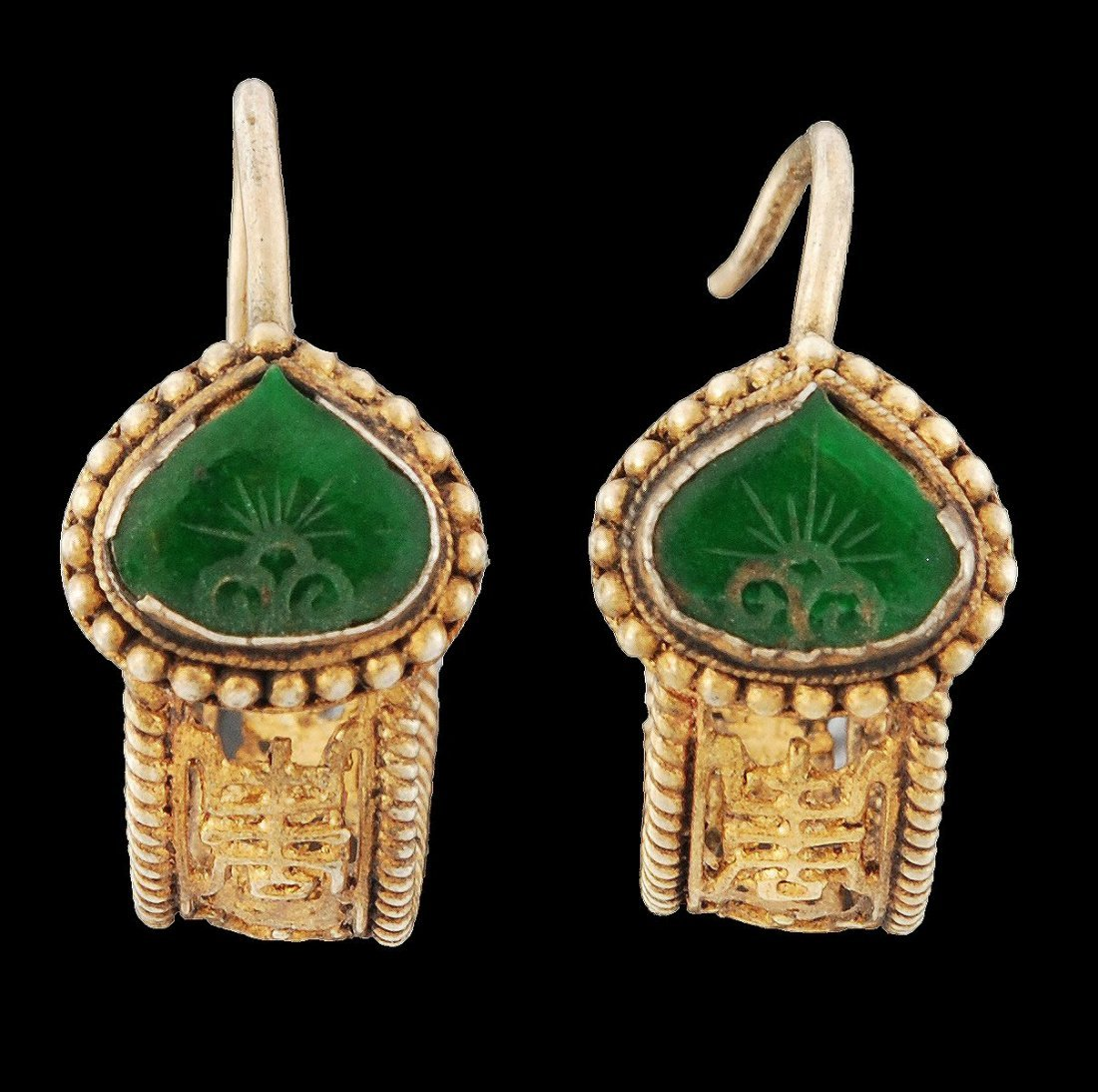 A pair of Chinese gilded and apple green glass ear