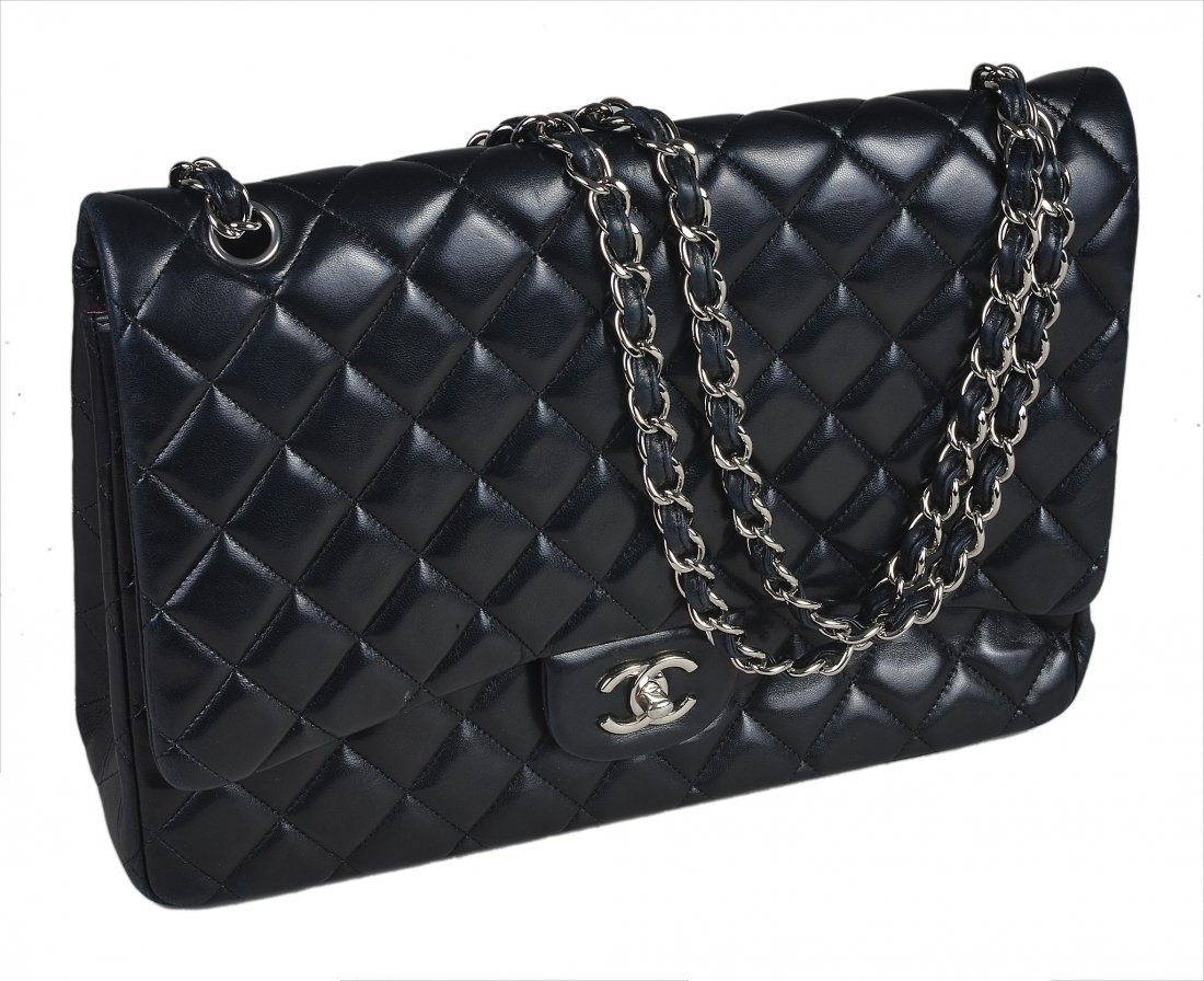Chanel, a black quilted lambskin leather 2
