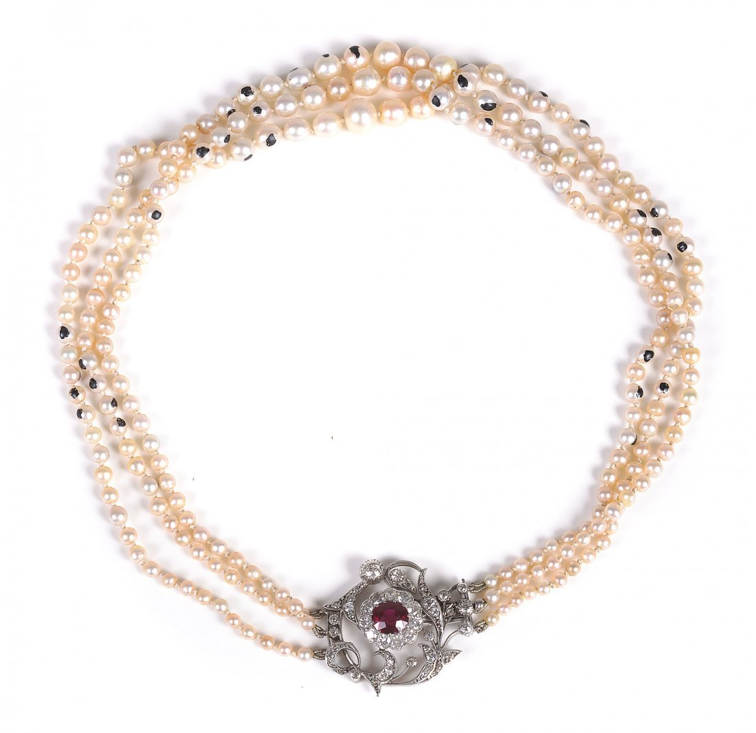 A three strand natural and cultured pearl necklace