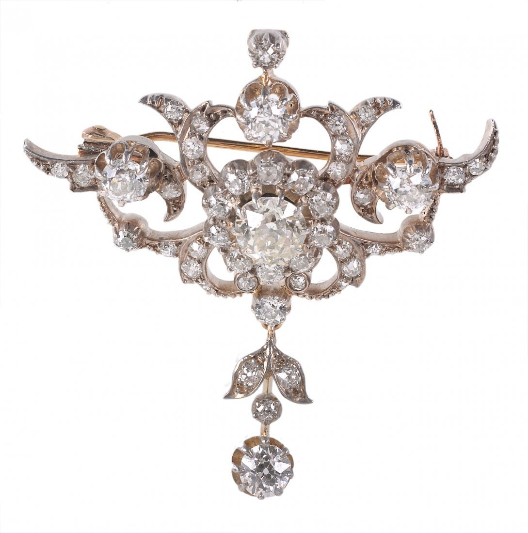A Victorian diamond scroll brooch, with a central