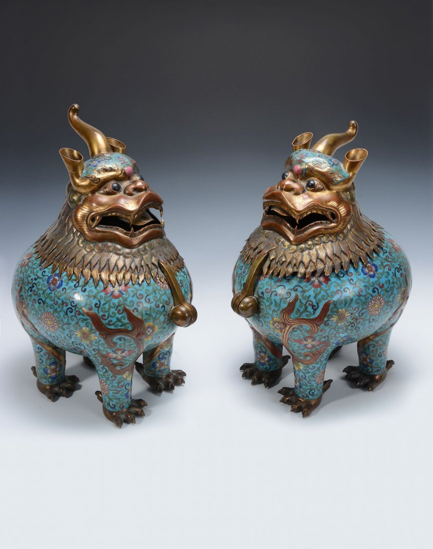 A rare pair of large cloisonne' mythical beast