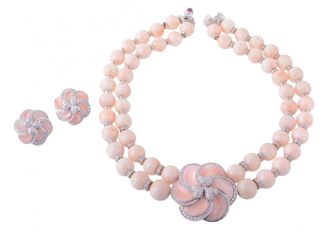 A coral and diamond necklace and a earrings