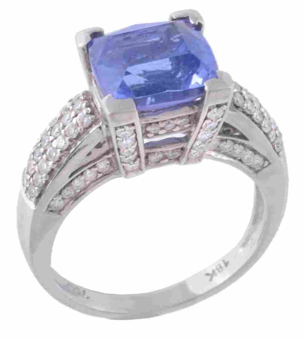 A tanzanite and diamond ring, the central fancy cut