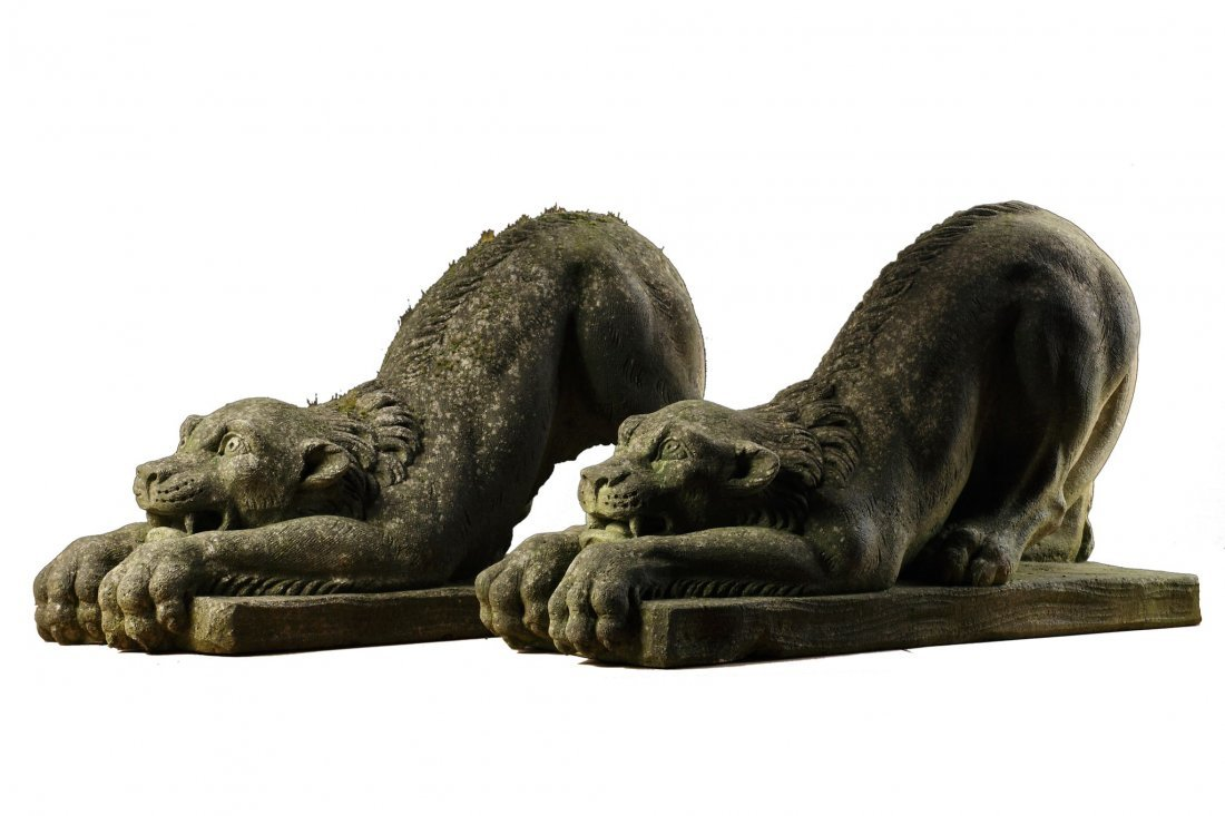 A pair of Continental sculpted limestone models of
