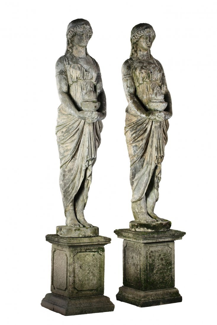 A pair of stone composition models of maidens, early